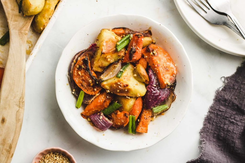 Miso Glazed Roasted Root Vegetables in a white bowl landscape photo