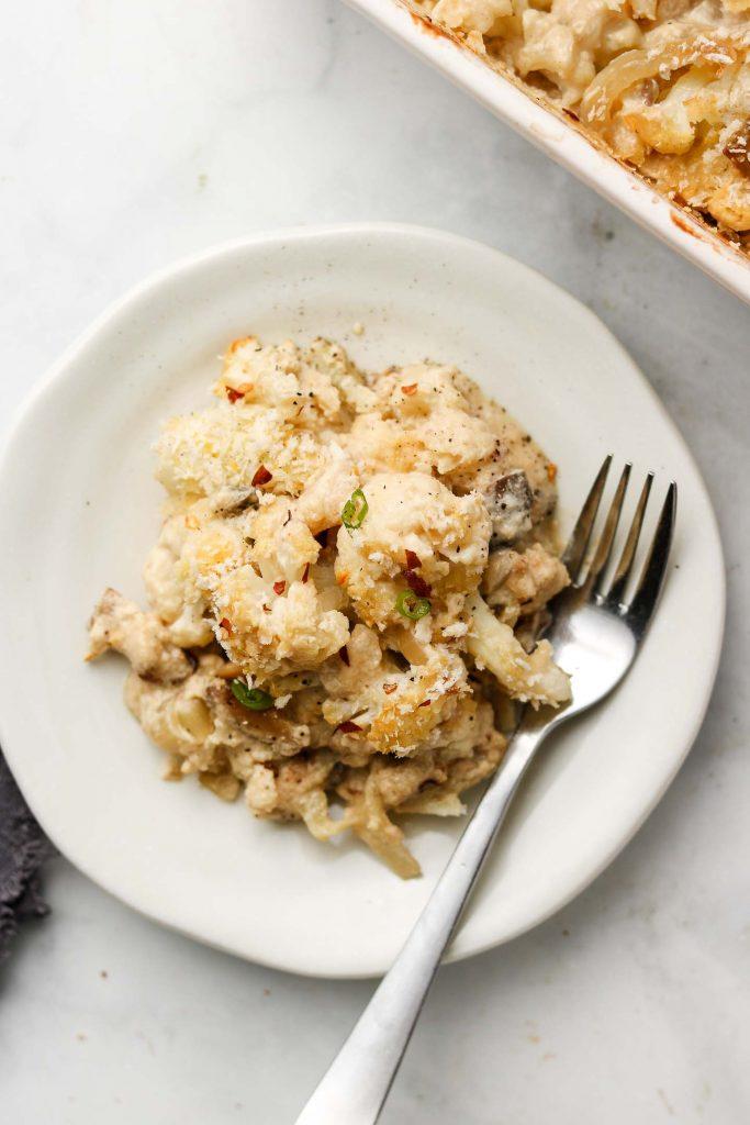 vegan cheesy cauliflower mushroom casserole on a plate