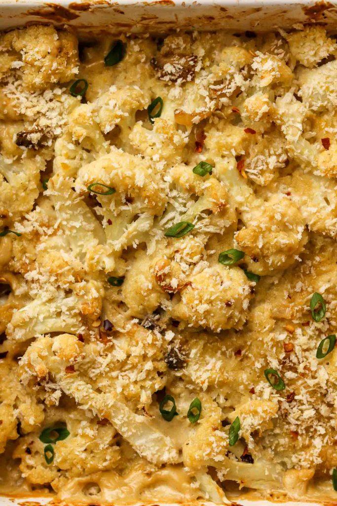 vegan cheesy cauliflower casserole with breadcrumbs close up