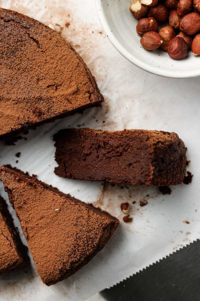 flourless hazelnut chocolate rum cake sliced side shot