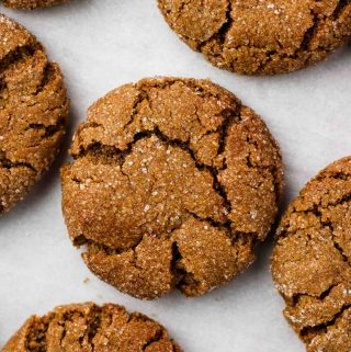 vegan ginger molasses cookies on a baking tray close up