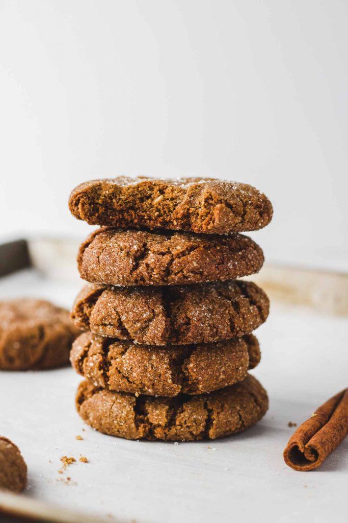 vegan ginger molasses cookies stacked with bite side shot