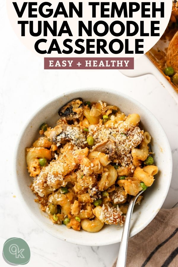 healthy vegan tempeh tuna noodle casserole in a bowl with breadcrumbs and a fork pinterest image
