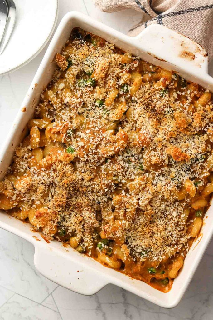 healthy dairy free gluten free tuna noodle casserole in a baking dish with breadcrumbs