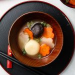 ozoni japanese new years mochi soup in a bowl with carrots and daikon landscape photo