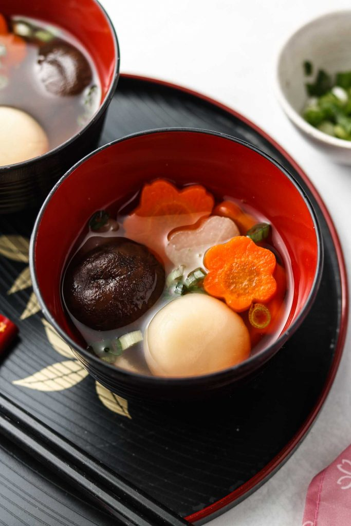 ozoni japanese new years mochi soup in a bowl with carrots and daikon kansai style