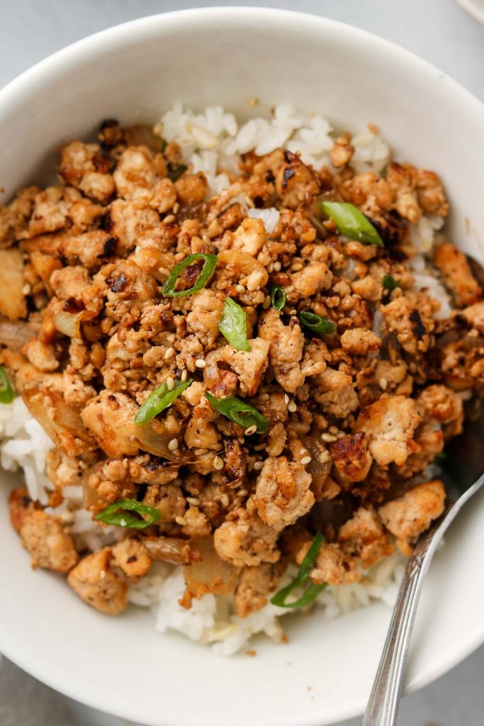 asian ground tofu crumbles over rice close up