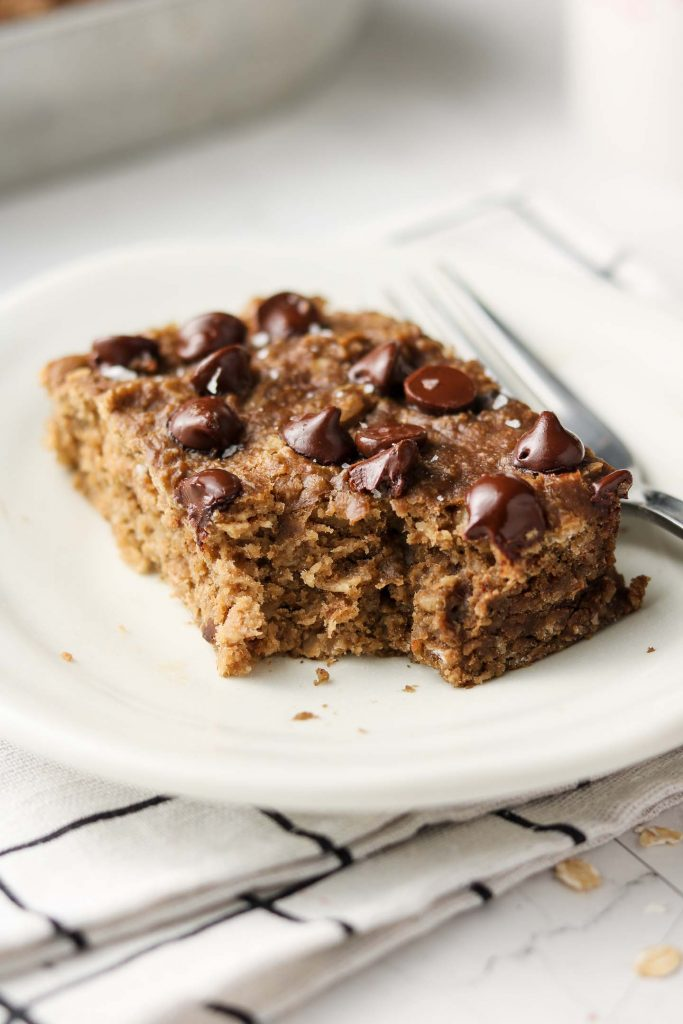 peanut butter banana bread bars with chocolate chips bite shot