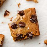 gluten free cashew butter blondies with chocolate chips and salt on top bite shot