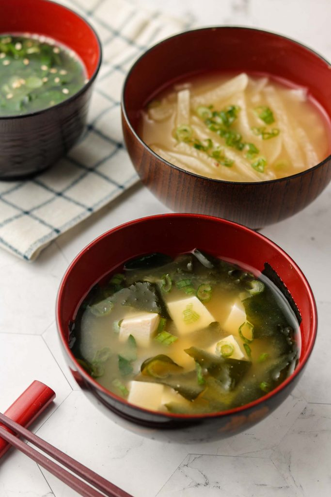 vegan miso soup in 3 bowls with 3 variations side shot