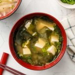 vegan tofu wakame green onion miso soup in a bowl