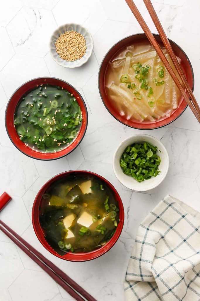 daikon, spinach, tofu and wakame vegan miso soup in a bowl