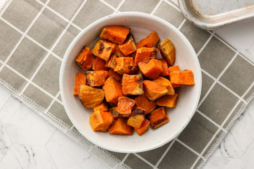 roasted sweet potatoes in a white bowl