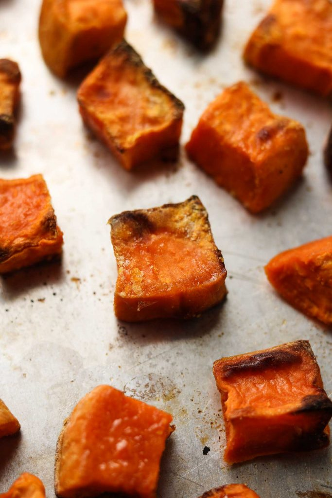 crispy roasted sweet potatoes on a baking tray