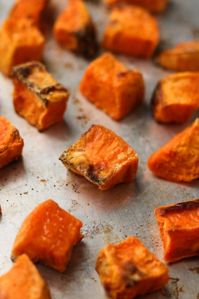 roasted sweet potatoes on a baking tray