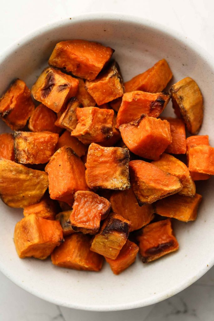 crispy roasted sweet potatoes in a bowl