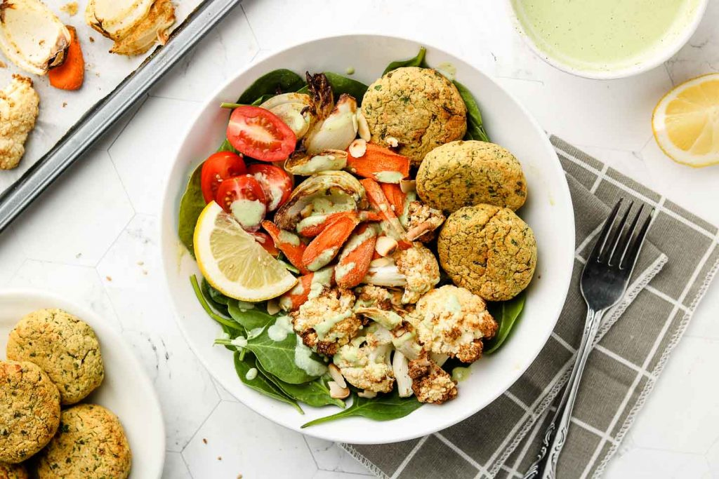 falafel patties in a buddha bowl with jalapeño CREAM SAUCE