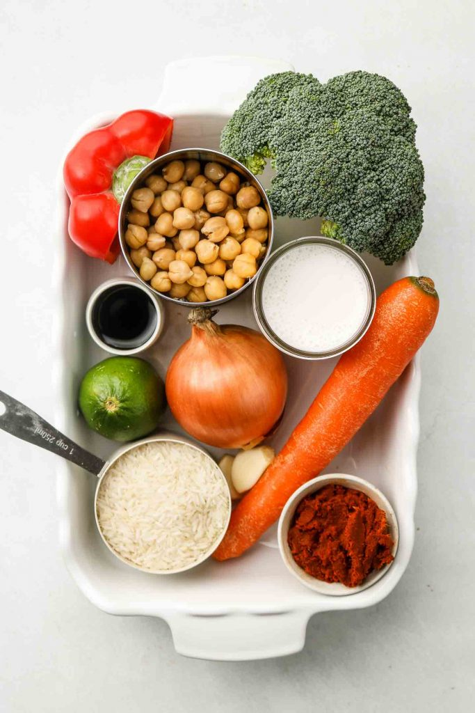 ingredients for red curry rice in a casserole dish