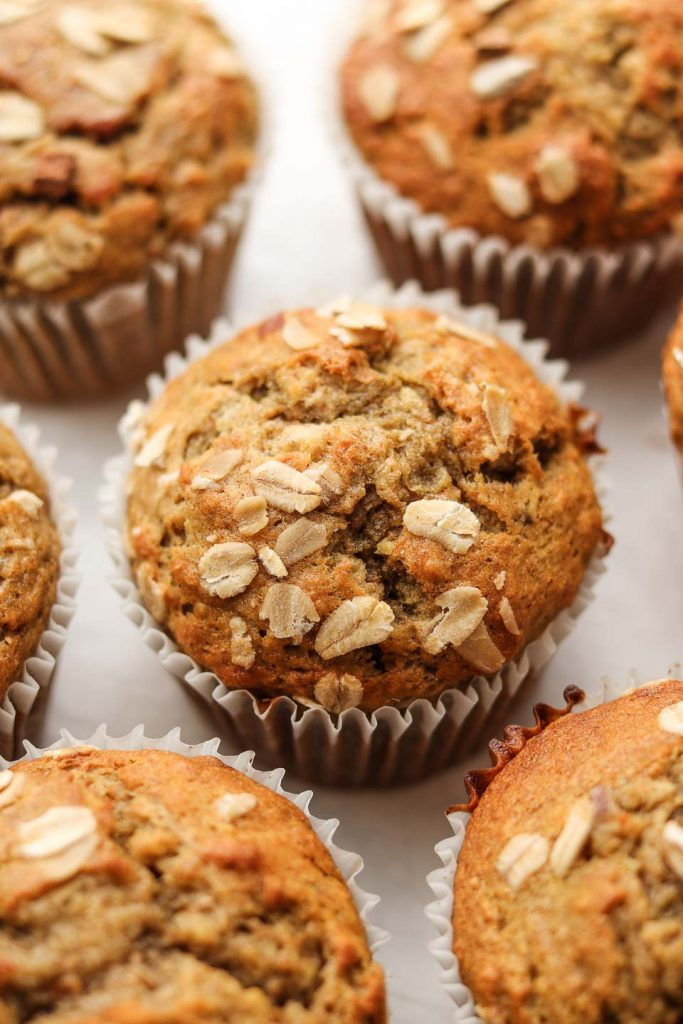 vegan banana oatmeal muffins with oats on top