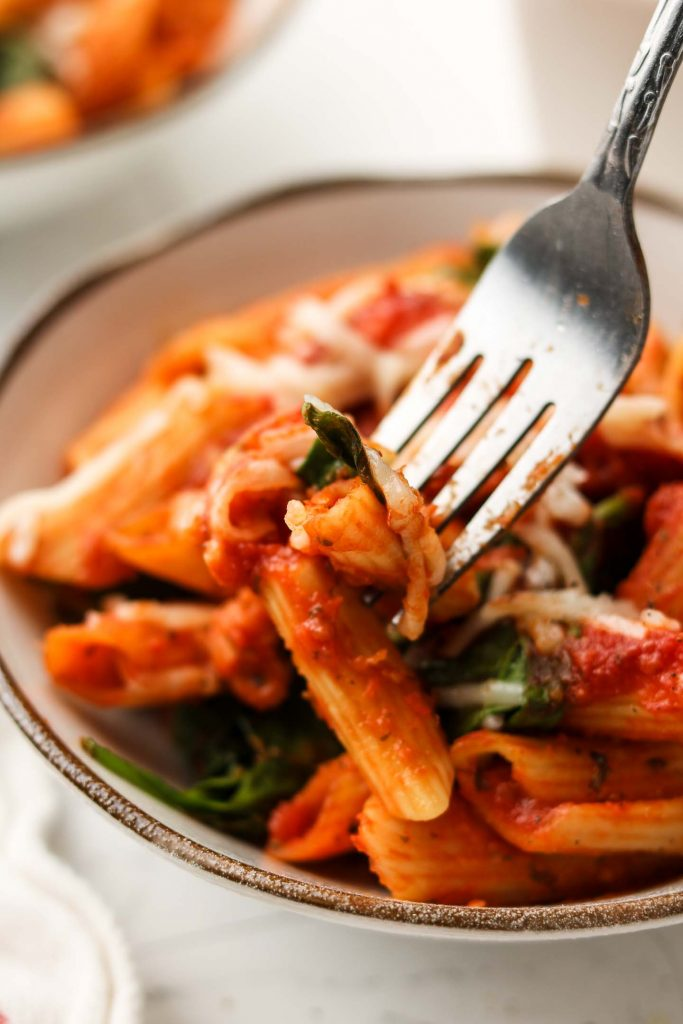 close up shot tomato cashew marinara penne baked pasta