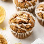 3/4 angle shot of lemon poppy seed muffins with glaze