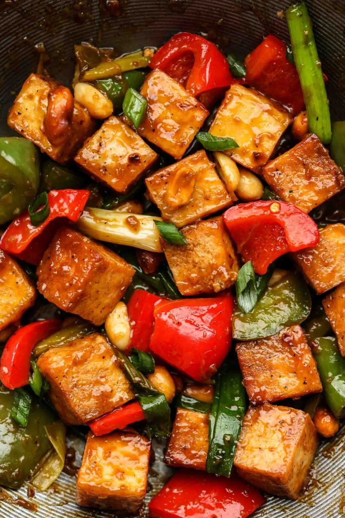 close up of kung pao tofu in a wok