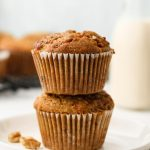 carrot cake muffins on a white plate stacked