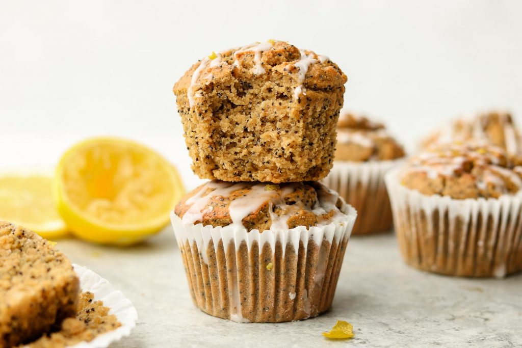 lemon poppy seed muffins stacked on each other with a bite shot