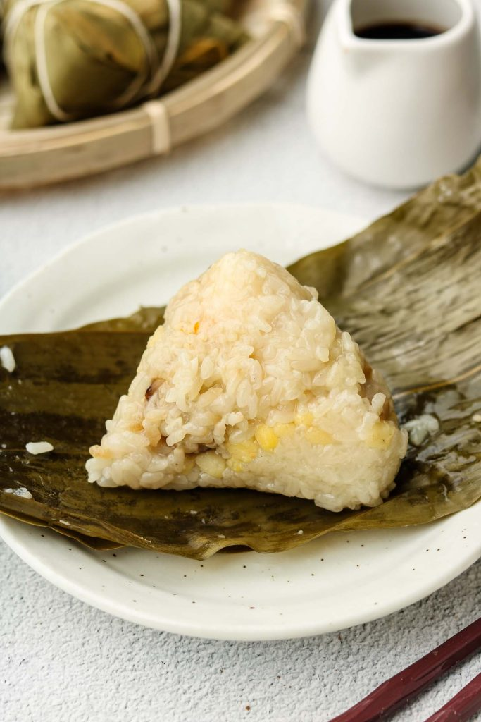 sticky rice dumpling on a bamboo leaf