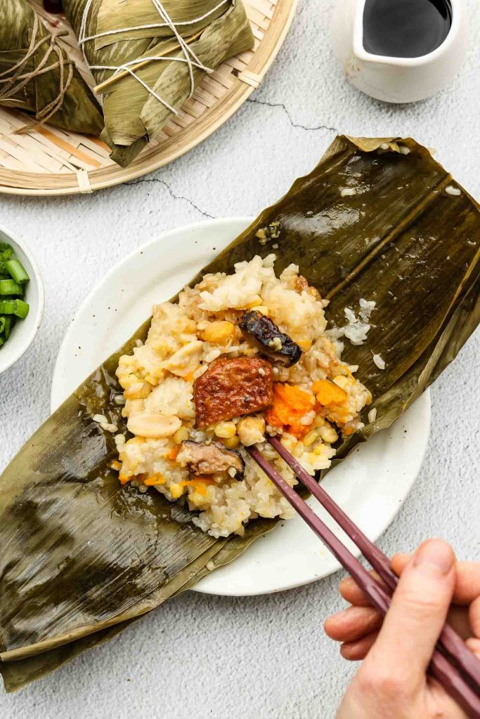 vegan zongzi unwrapped bamboo leaves on a plate