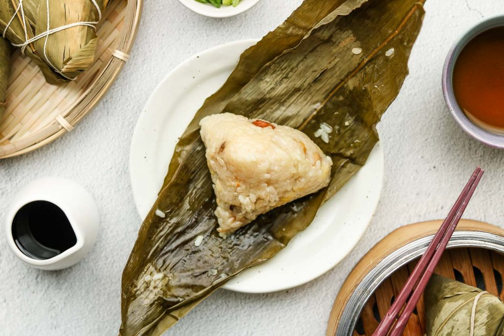 glutinous rice steamed in bamboo leaves on a plate