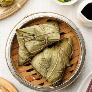 chinese sticky rice in a bamboo steamer basket