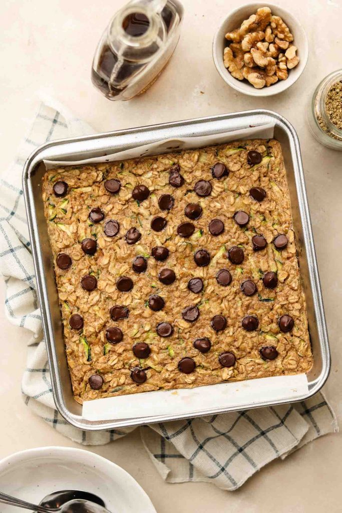 zucchini bread baked oatmeal in a 8x8 inch baking pan with chocolate chips on top