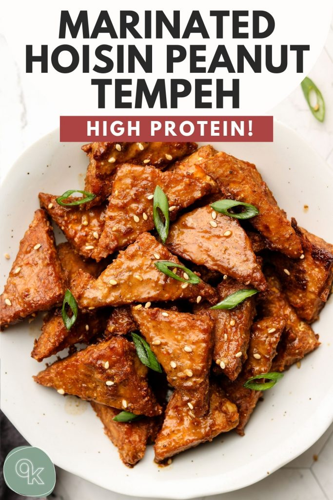 marinated peanut tempeh in a white bowl pinterest graphic