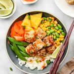 crispy tofu, mixed vegetables and pineapple over rice covered in sweet chili sauce