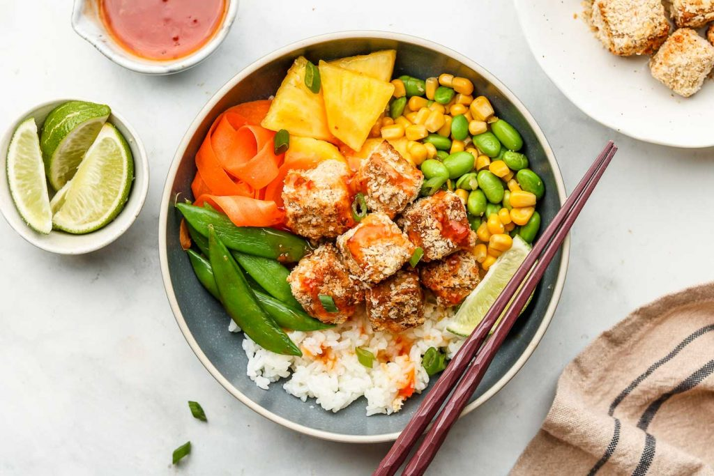 sweet chili rice bowls WITH crispy coconut tofu and vegetables on top