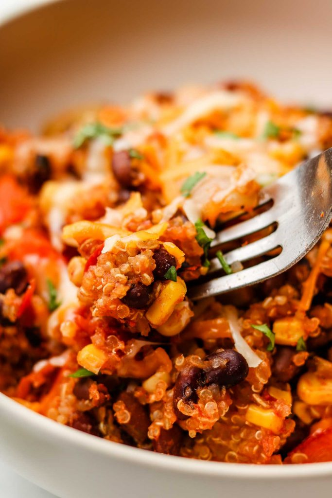 close up shot of quinoa taco rice in a bowl with a fork