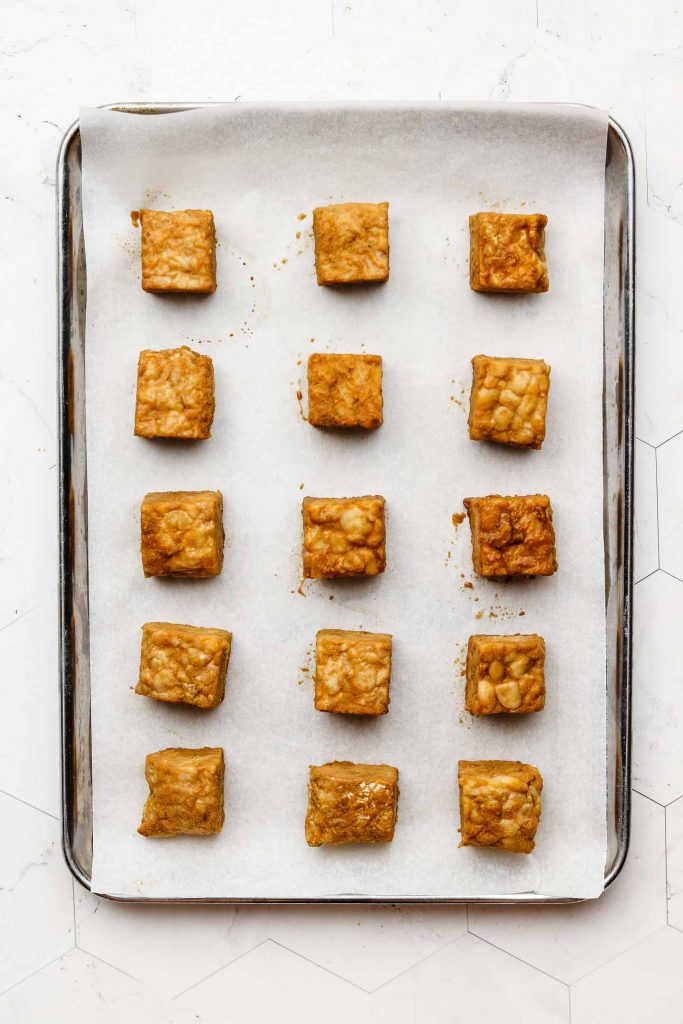 cubed tempeh on baking tray