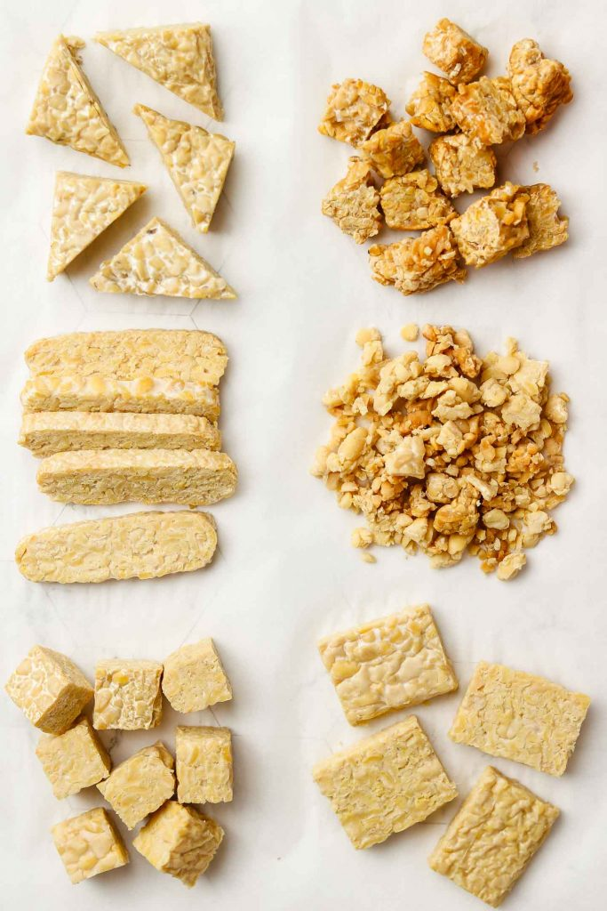 tempeh cut up in triangles, cubes, strips, crumbles, squares and torn