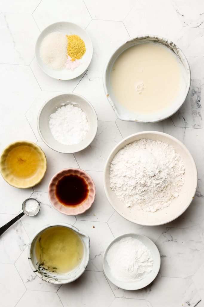 ingredients for fluffy japanese pancakes on a marble backdrop