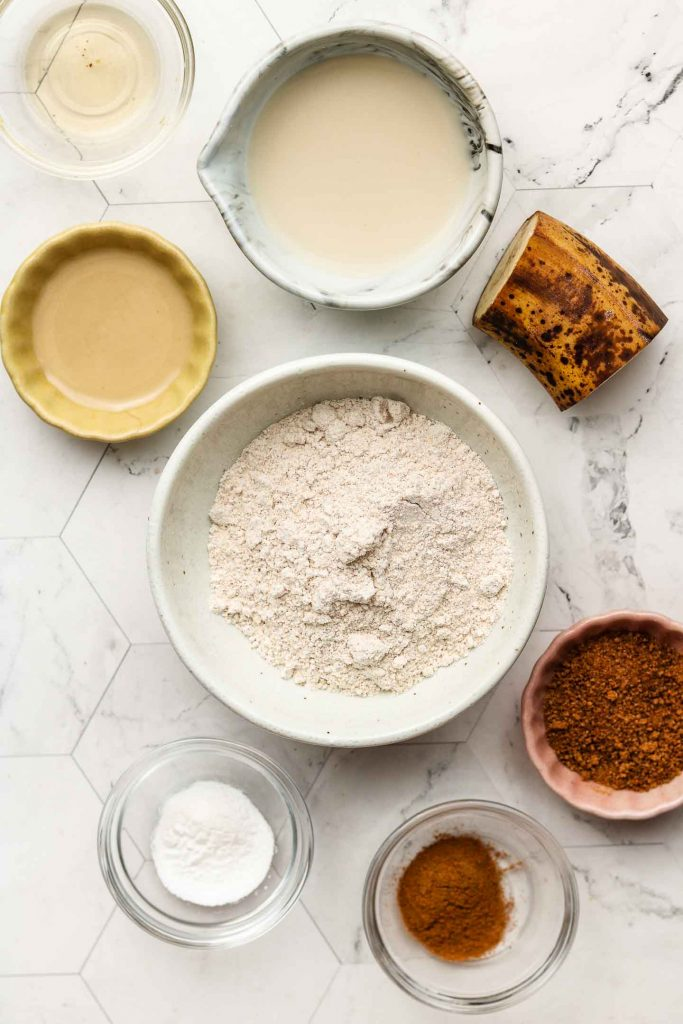 ingredients for cinnamon mug cake on a white back drop