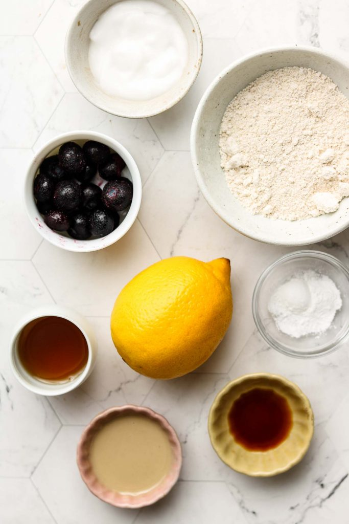 ingredients for lemon blueberry cake on a marble top