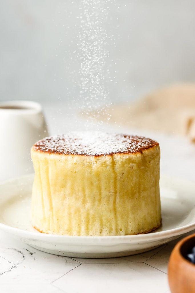 dusting powder sugar over a thick pancake