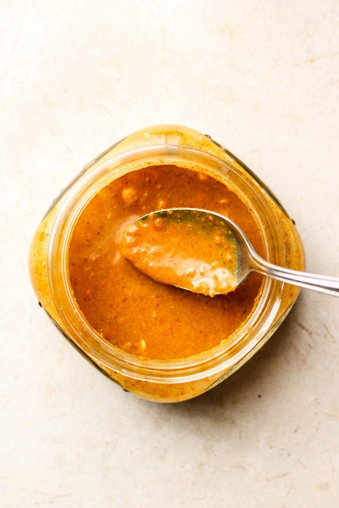 satay peanut tempeh marinade in a flat mason jar