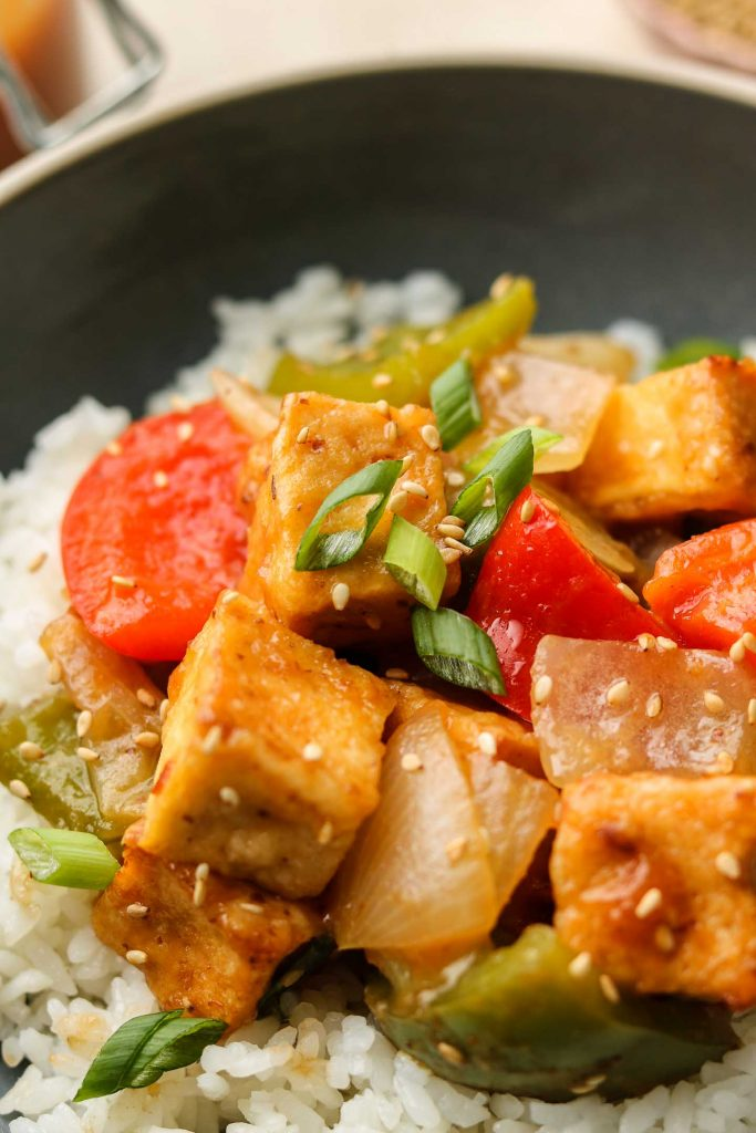 close up shot of air fried tofu in a bowl