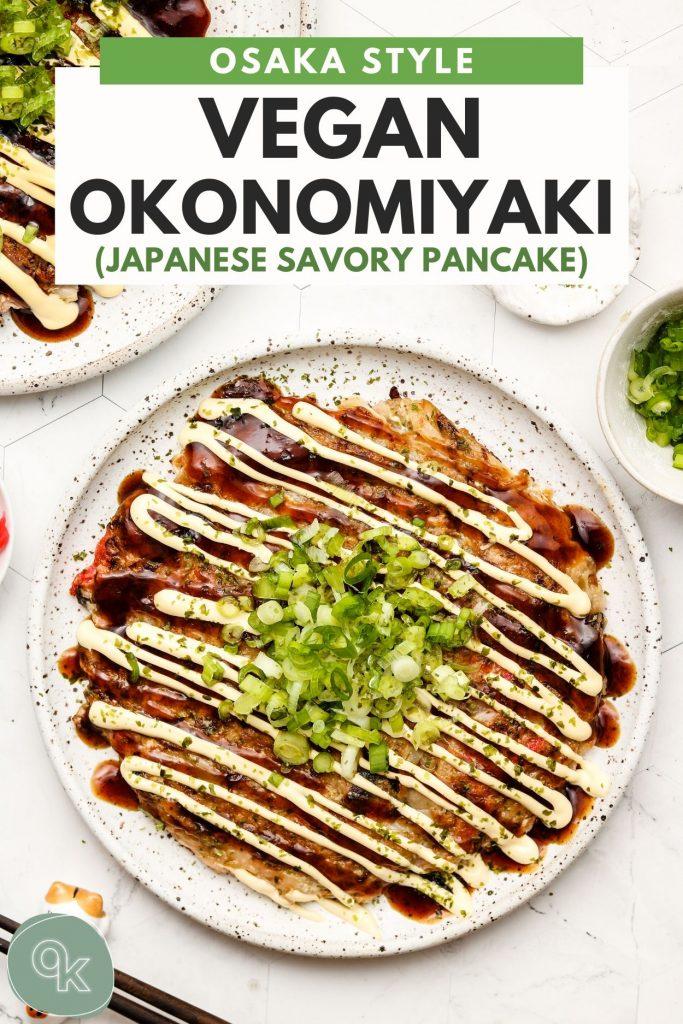 vegan okonomiyaki on a white speckled plate with pinterest text overlay