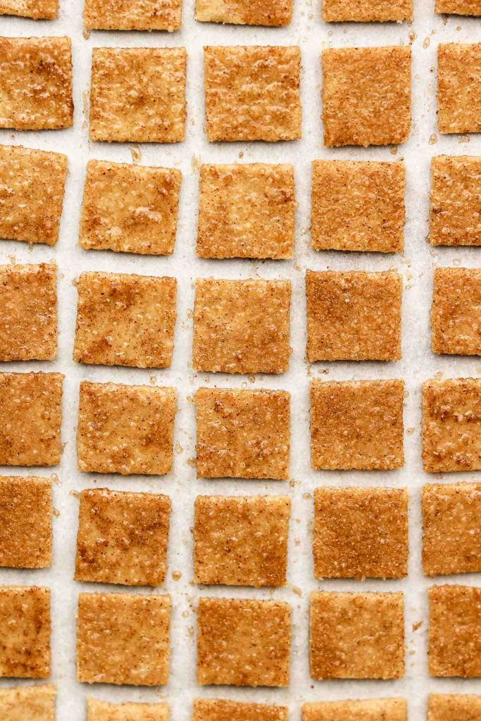 cinnamon toast crunch on a baking sheet with parchment paper