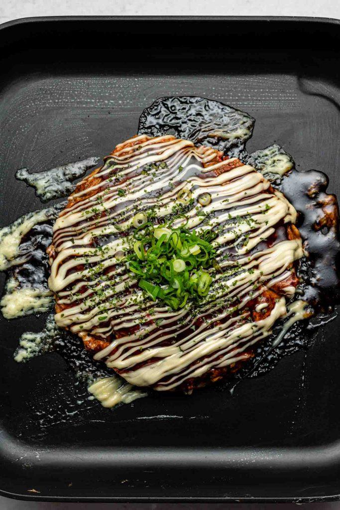 authentic okonomiyaki on a griddle tepan