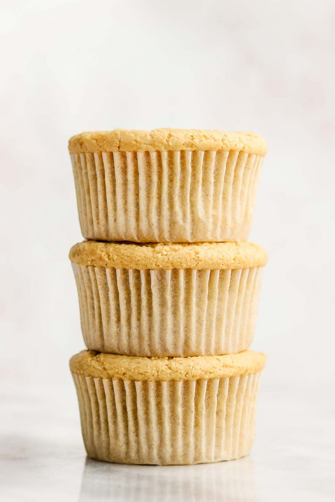 3 vanilla cupcakes stacked on each other