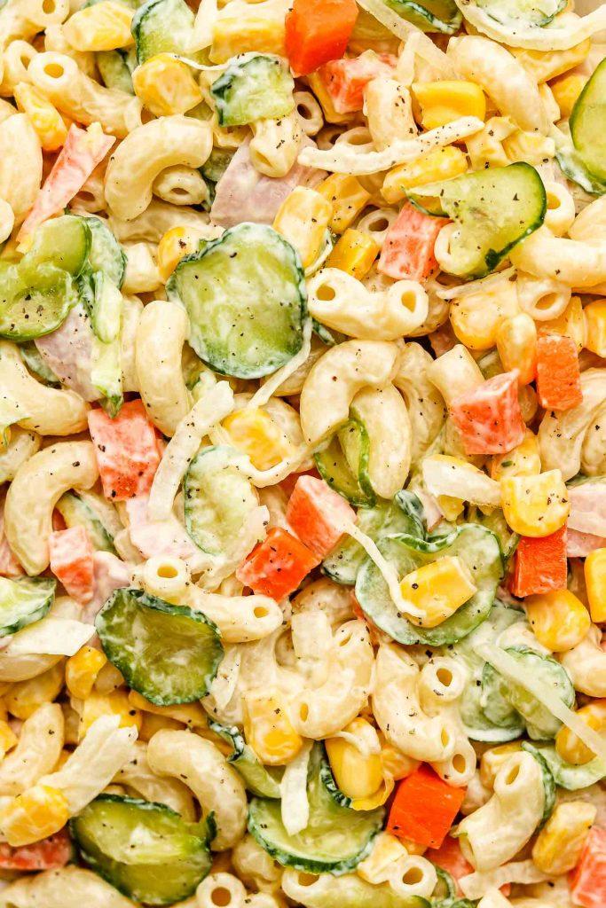 close up shot of japanese macaroni salad with cucumbers, carrots, corn and vegan ham